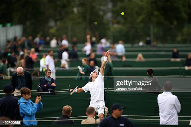 James McGee of Ireland serves during his first round qualifying match against Aljaz Bedene of Slovenia on day one of the Wimbledon Championships 2014...