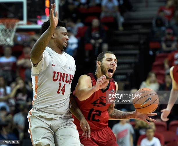 James McGee of the Southern Utah Thunderbirds draws a foul from Tervell Beck of the UNLV Rebels at the Thomas Mack Center on November 25 2017 in Las...