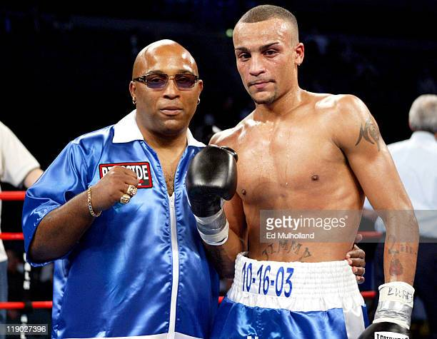 James McGirt Jr poses with his father and trainer James Buddy McGirt after winning his pro debut against James North The bout was on the undercard of...