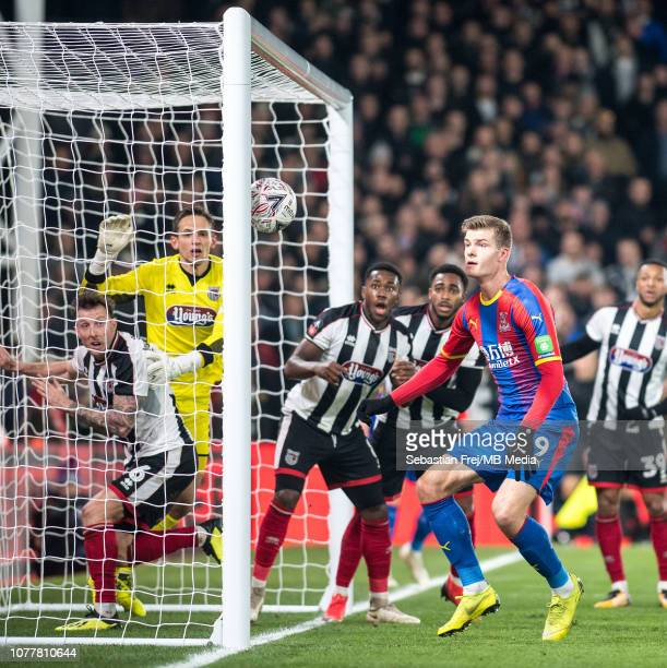James McKeown and Martyn Woolford of Grimsby Town defend shot of Alexander Sorloth of Crystal Palace during the FA Cup Third Round match between...