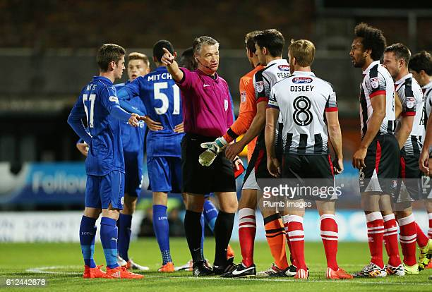 James McKeown of Grimsby Town being sent off by referee Mark Haywood during the checkatrade Trophy match between Grimsby Town and Leicester City at...
