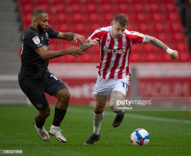 James McLean of Stoke City and Bryan Mbeumo of Brentford in action during the Sky Bet Championship match between Stoke City and Brentford at Bet365...
