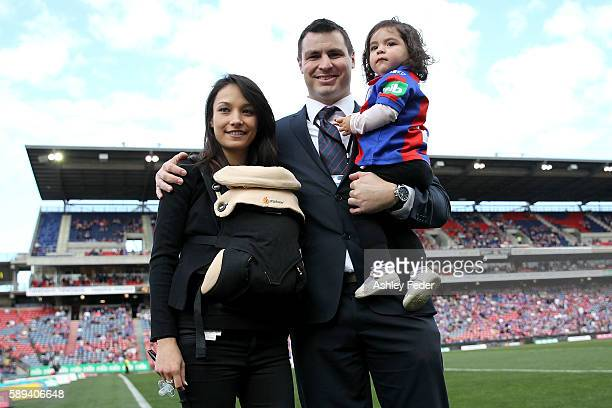 James McManus ex Knights poses with his family for a photo during the round 23 NRL match between the Newcastle Knights and the Penrith Panthers at...