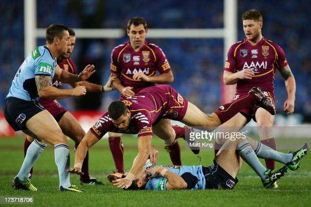 James McManus of the Blues is hit high in a tackle by Greg Inglis of the Maroons during game three of the ARL State of Origin series between the New...