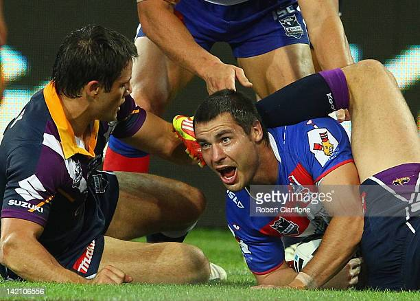 James McManus of the Knights celebrates after scoring a try during the round five NRL match between the Melbourne Storm and the Newcastle Knights at...