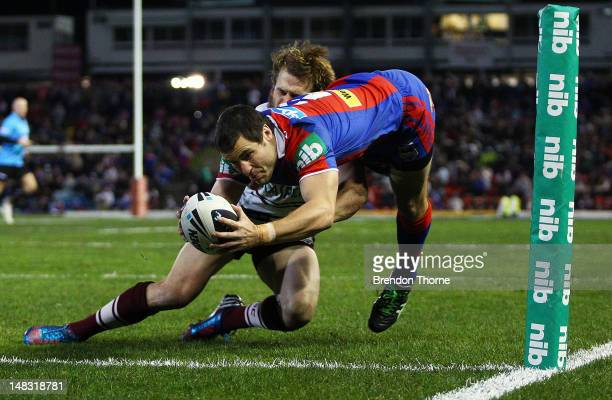 James McManus of the Knights dives for the try line to score against the Sea Eagles during the round 19 NRL match between the Newcastle Knights and...