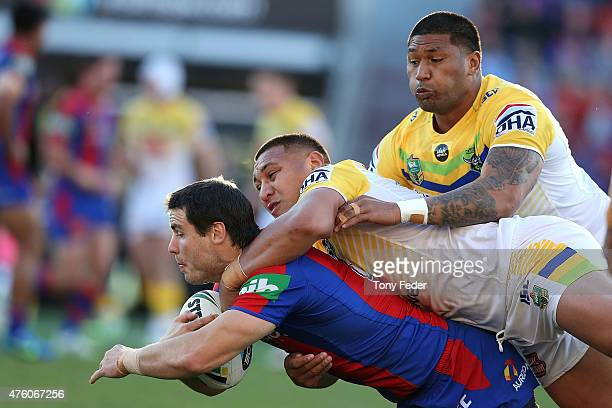 James McManus of the Knights is tackled by the Raiders defence during the round 13 NRL match between the Newcastle Knights and Canberra Raiders at...