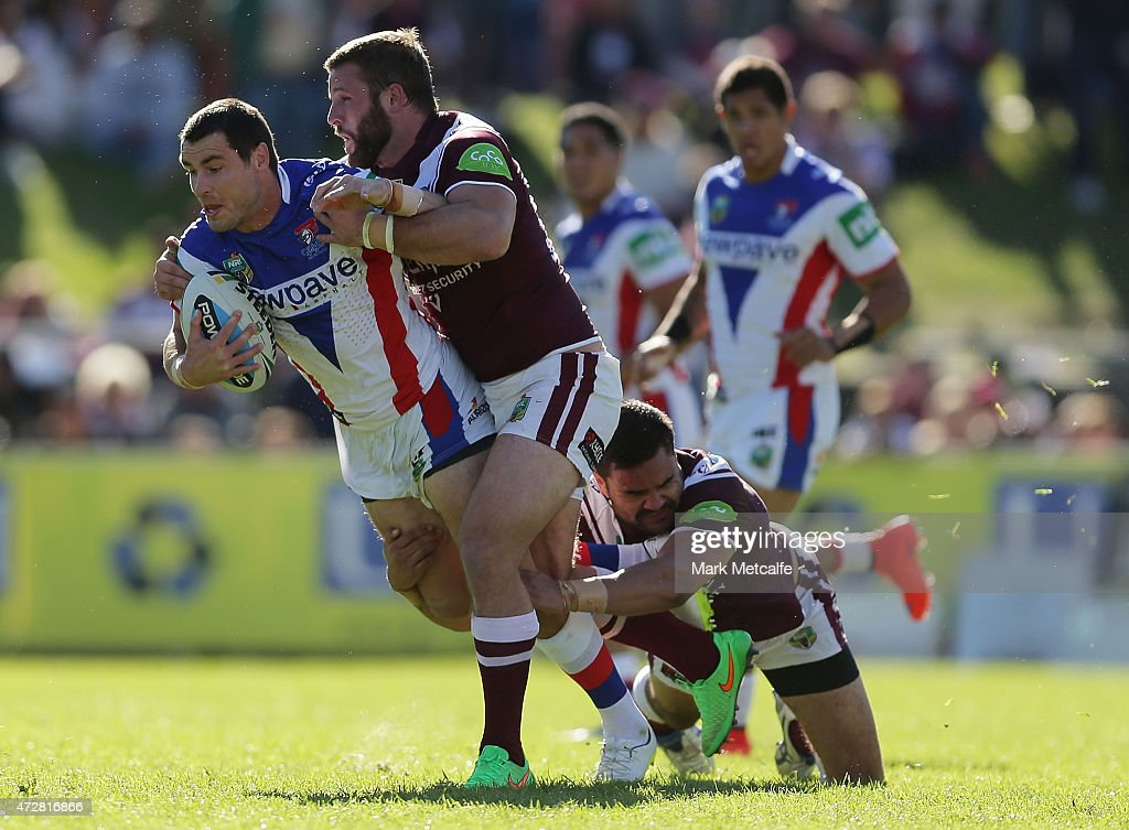 James McManus of the Knights is tackled during the round nine NRL match between the Manly Sea Eagles and the Newcastle Knights at Brookvale Oval on May 10, 2015 in Sydney, Australia.