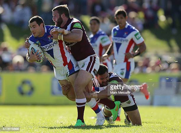 James McManus of the Knights is tackled during the round nine NRL match between the Manly Sea Eagles and the Newcastle Knights at Brookvale Oval on...