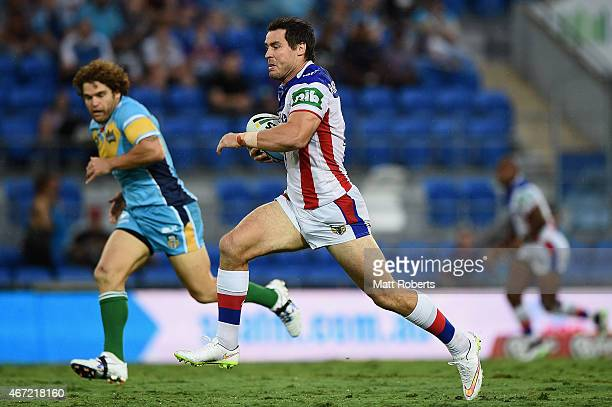 James McManus of the Knights makes a break during the round three NRL match between the Gold Coast Titans and the Newcastle Knights at Cbus Super...