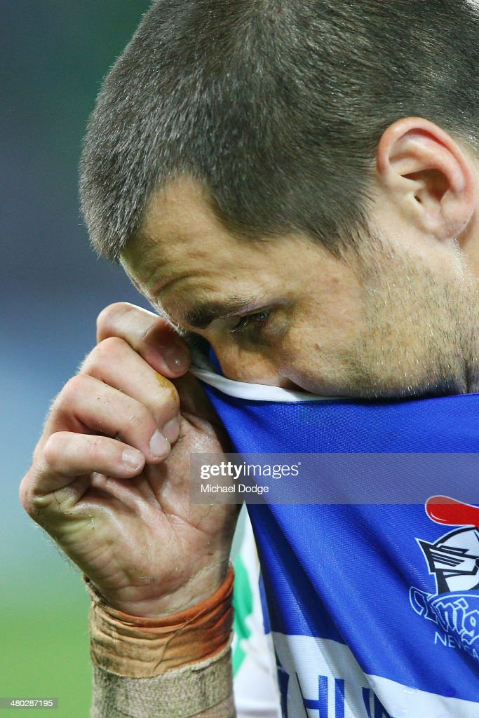 James McManus of the Knights reacts after their defeat during the round three NRL match between the Melbourne Storm and the Newcastle Knights at AAMI Park on March 24, 2014 in Melbourne, Australia.