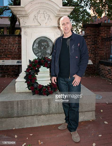 James McTeigue poses for a photo after laying a wreath on the grave of Edgar Allan Poe on the 162nd anniversary of his death at Westminster Hall on...