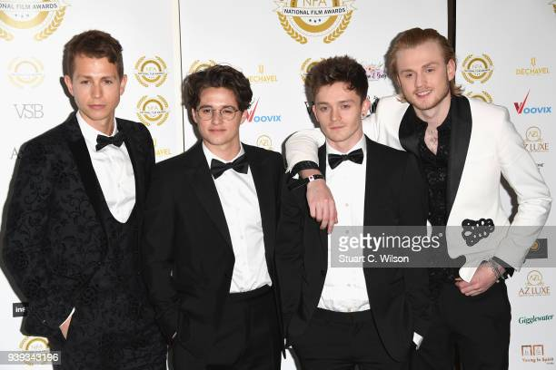 James McVey Brad Simpson Connor Ball and Tristan Evans of The Vamps attend the National Film Awards UK at Porchester Hall on March 28 2018 in London...