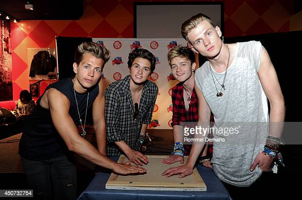 James McVey Brad Simpson Connor Ball and Tristan Evans visits at Planet Hollywood Times Square on June 16 2014 in New York City