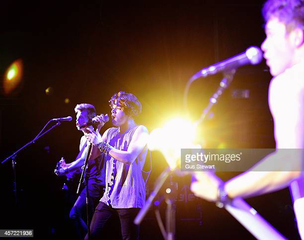James McVey Bradley Simpson and Connor Ball of The Vamps perform at Hammersmith Apollo on October 14 2014 in London England