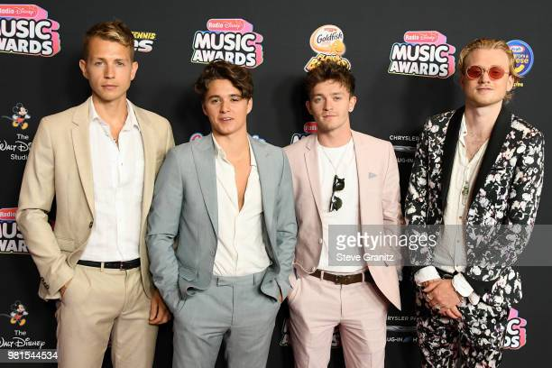 James McVey Connor Ball Tristan Evans and Bradley Simpson of The Vamps attend the 2018 Radio Disney Music Awards at Loews Hollywood Hotel on June 22...