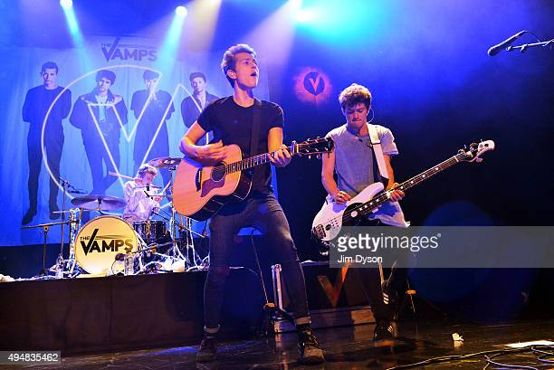 James McVey Tristan Evans and Connor Ball of The Vamps perform live on stage during a fanfest ahead of the launch of their new album at Indigo2 at...