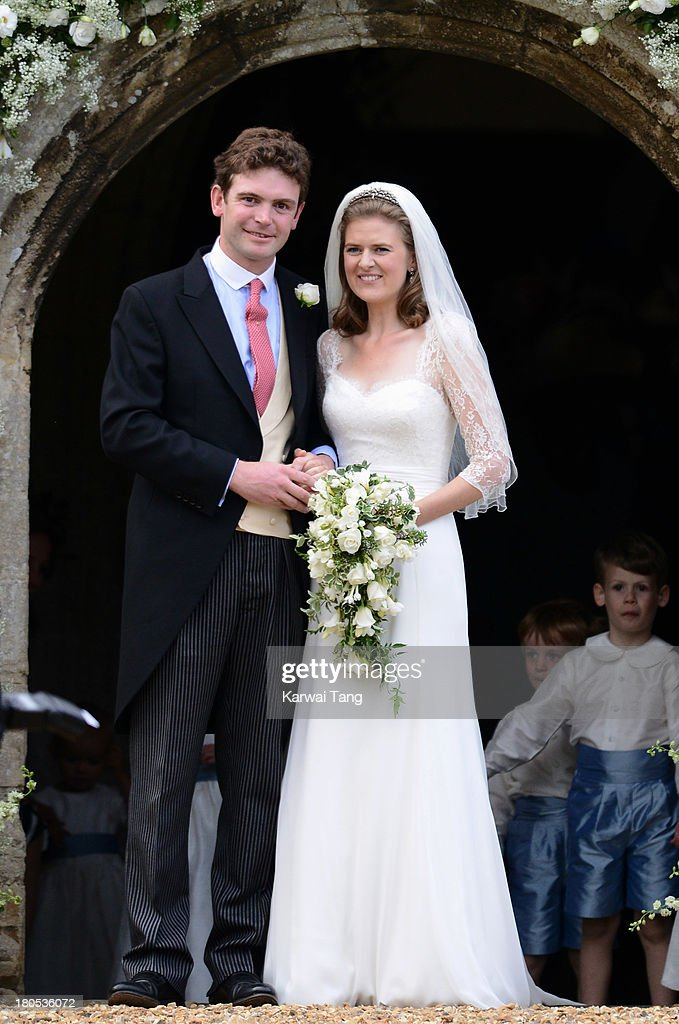 James Meade and Lady Laura Marsham are seen during their wedding at The Parish Church of St. Nicholas in Gayton on September 14, 2013 in King's Lynn, England.
