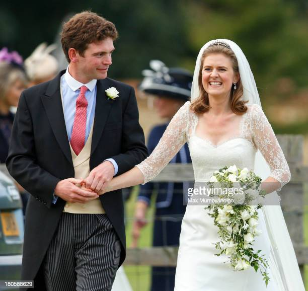 James Meade and Lady Laura Marsham leave the Parish Church of St Nicholas in Gayton after their wedding on September 14 2013 near King's Lynn England