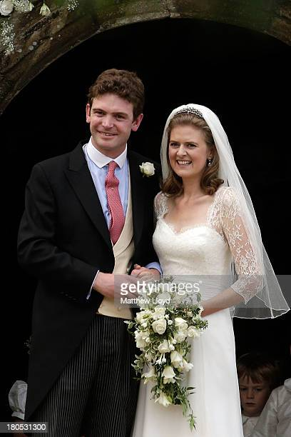 James Meade and Lady Laura Marsham pose for photographs after their wedding at St Nicholas' Church in Gayton on September 14 2013 in King's Lynn...