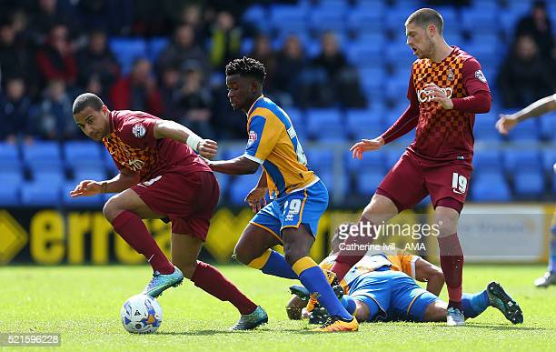 James Meredith of Bradford City and Larnell Cole of Shrewsbury Town during the Sky Bet League One match between Shrewsbury Town and Bradford City at...