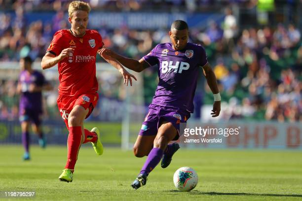 James Meredith of the Perth Glory fends off Ben Halloran of Adelaide United to take possession of the ball during the round 14 A-League match between...