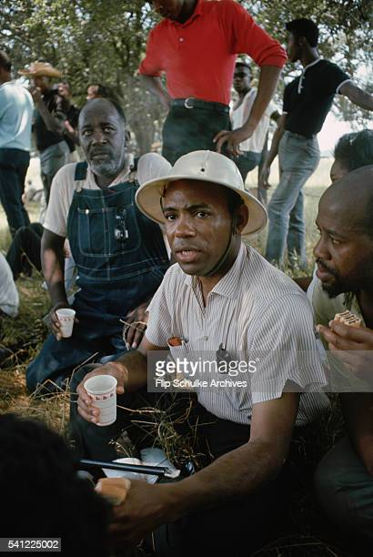 James Meredith rests under shady trees with other marchers along a highway during the March Against Fear through rural Mississippi Meredith the first...