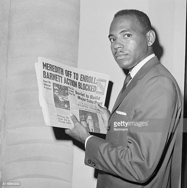 James Meredith the first African American student to enroll at the University of Mississippi holds a newspaper as he attempts to register at the...