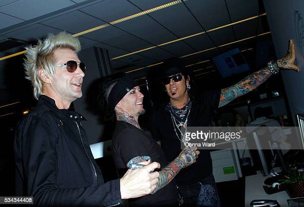 James Michael DJ Ashba and Nikki Sixx of SixxAM appear to promote Prayers or the Damned Vol 1 during AOL BUILD Seriesat AOL Studios In New York on...
