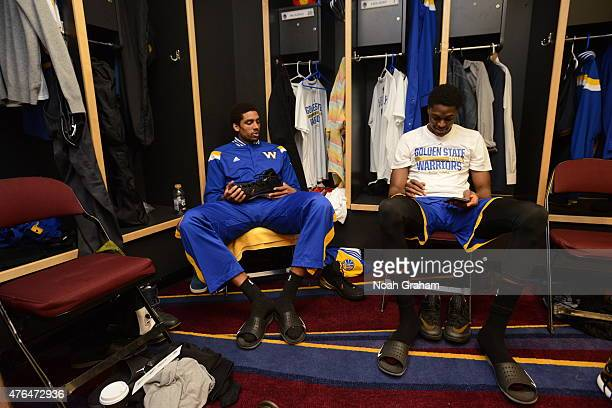 James Michael McAdoo and Justin Holiday of the Golden State Warriors get ready in the locker room before a game against the Cleveland Cavaliers in...