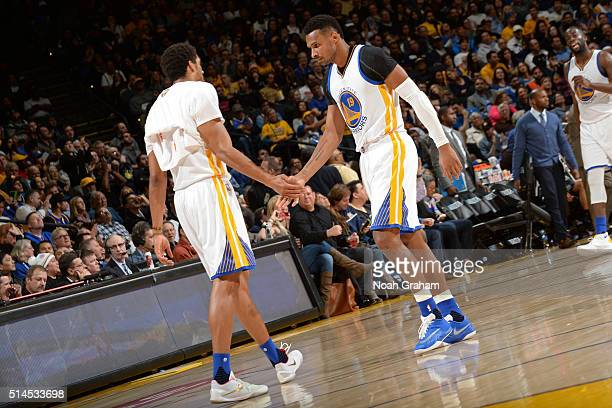 James Michael McAdoo and Leandro Barbosa of the Golden State Warriors shake hands during the game against the Orlando Magic on March 7 2016 at ORACLE...