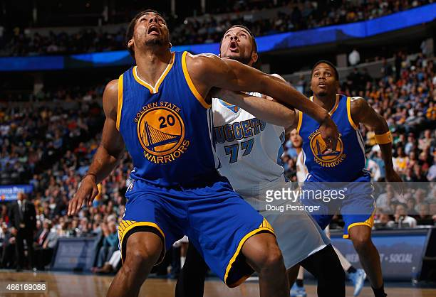 James Michael McAdoo of the Golden State Warriors and Joffrey Lauvergne of the Denver Nuggets battle for rebounding position as Brandon Rush of the...