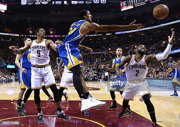 James Michael McAdoo of the Golden State Warriors and Kyrie Irving of the Cleveland Cavaliers reach for the ball during the first half in Game 4 of...