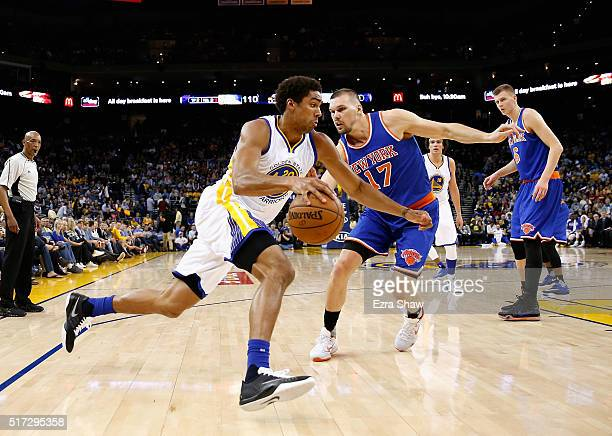 James Michael McAdoo of the Golden State Warriors dribbles past Lou Amundson of the New York Knicks at ORACLE Arena on March 16 2016 in Oakland...