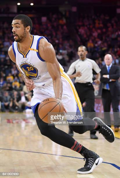 James Michael McAdoo of the Golden State Warriors drives towards the basket against Jeremy Lamb of the Charlotte Hornets during an NBA basketball...