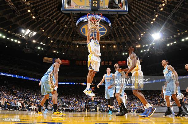 James Michael McAdoo of the Golden State Warriors dunks against the Denver Nuggets on April 15 2015 at Oracle Arena in Oakland California NOTE TO...