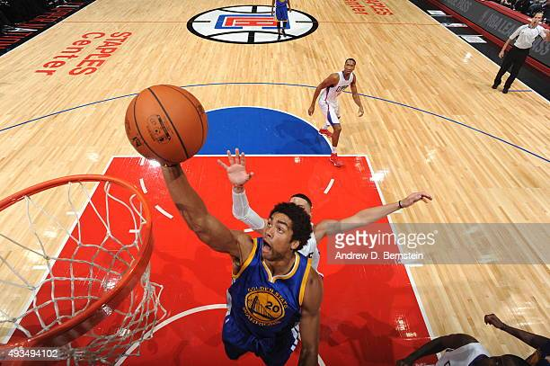 James Michael McAdoo of the Golden State Warriors goes to the basket against the Los Angeles Clippers on October 20 2015 at STAPLES Center in Los...