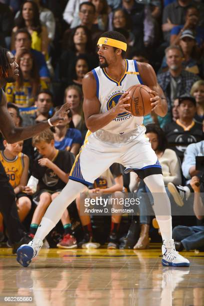 James Michael McAdoo of the Golden State Warriors handles the ball against the Houston Rockets on March 31 2017 at ORACLE Arena in Oakland California...