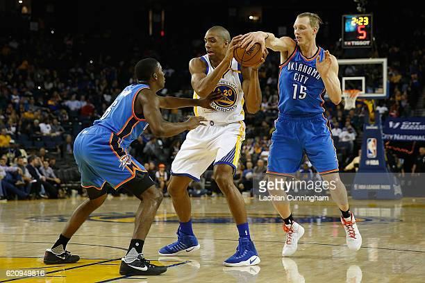 James Michael McAdoo of the Golden State Warriors looks to pass the ball against Semaj Christon and Kyle Singler of the Oklahoma City Thunder at...