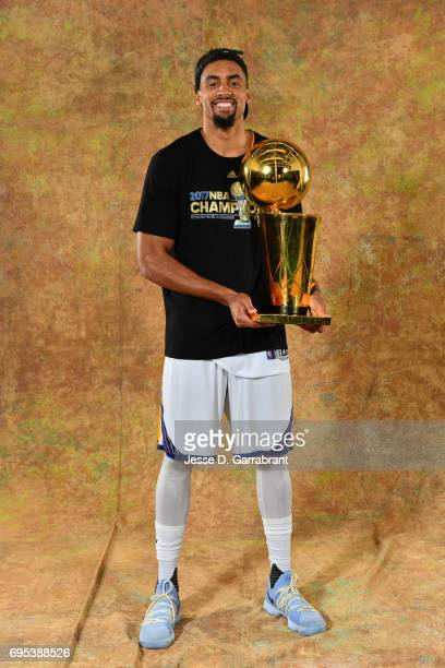 James Michael McAdoo of the Golden State Warriors poses for a portrait with the Larry O'Brien Trophy after defeating the Cleveland Cavaliers in Game...