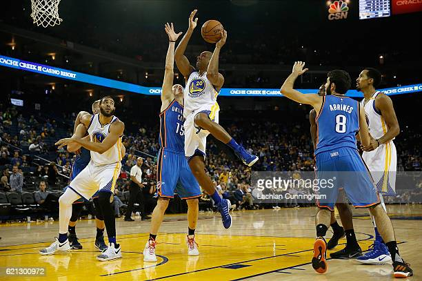 James Michael McAdoo of the Golden State Warriors shoots the ball over Kyle Singler of the Oklahoma City Thunder at ORACLE Arena on November 3 2016...