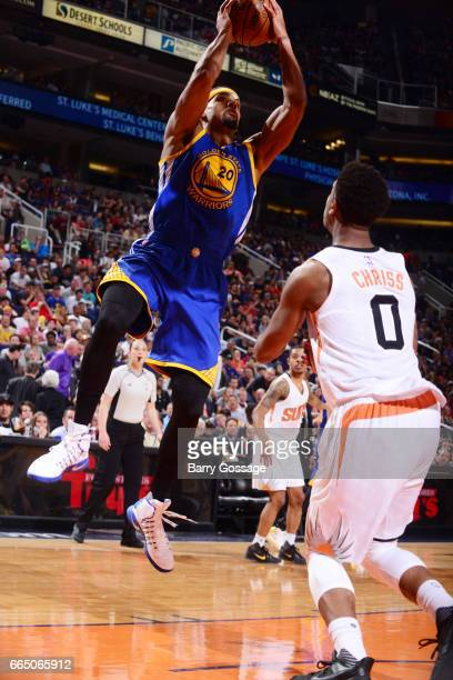 James Michael McAdoo of the Golden State Warriors shoots the ball against the Phoenix Suns on April 5 2017 at Talking Stick Resort Arena in Phoenix...