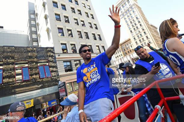James Michael McAdoo of the Golden State Warriors waves to the crowd during the Victory Parade and Rally on June 15 2017 in Oakland California at The...