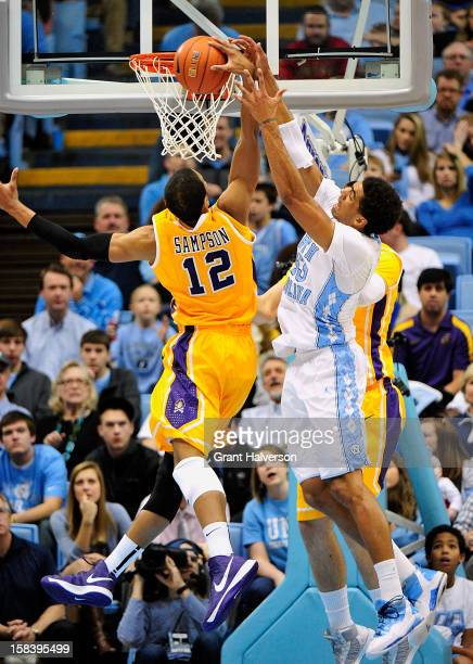 James Michael McAdoo of the North Carolina Tar Heels battles for a rebound with Robert Sampson of the East Carolina Pirates during play at the Dean...
