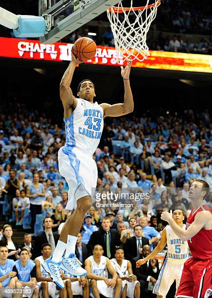 James Michael McAdoo of the North Carolina Tar Heels drives to the basket against the Davidson Wildcats during their game at the Dean Smith Center on...