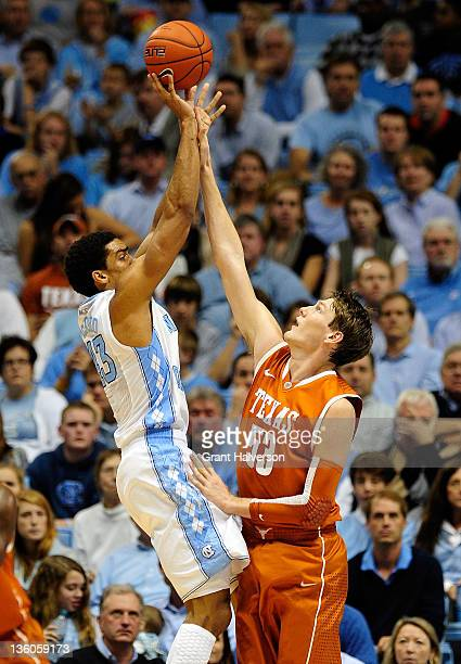James Michael McAdoo of the North Carolina Tar Heels has his shot blocked by Clint Chapman of the Texas Longhorns during play at Dean Smith Center on...
