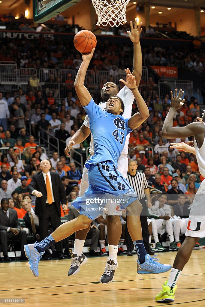 James Michael McAdoo #43 of the North Carolina Tar Heels puts up a shot against Reggie Johnson #42 of the Miami Hurricanes at the BankUnited Center on February 9, 2013 in Coral Gables, Florida.
