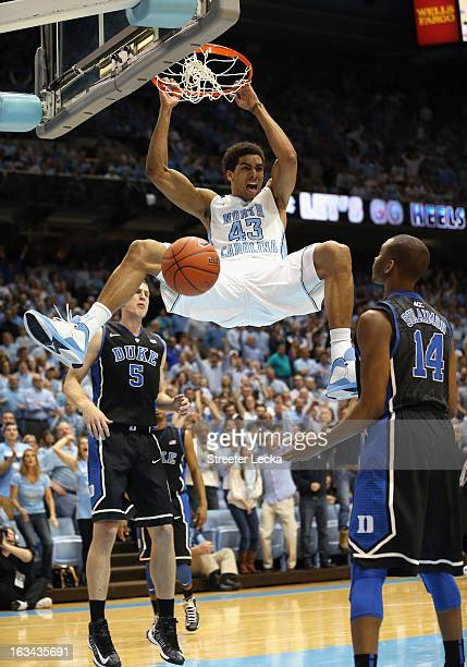 James Michael McAdoo of the North Carolina Tar Heels reacts after dunking the ball as teammates Mason Plumlee and Rasheed Sulaimon of the Duke Blue...
