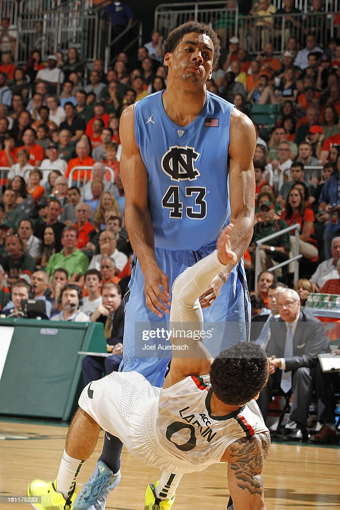 James Michael McAdoo #43 of the North Carolina Tar Heels runs into Shane Larkin #0 of the Miami Hurricanes and receives an offensive foul on February 9, 2013 at the BankUnited Center in Coral Gables, Florida. Miami defeated North Carolina 87-61.