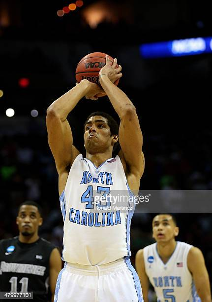 James Michael McAdoo of the North Carolina Tar Heels shoots a free throw against the Providence Friars during the closing seconds of the Tar Heels...